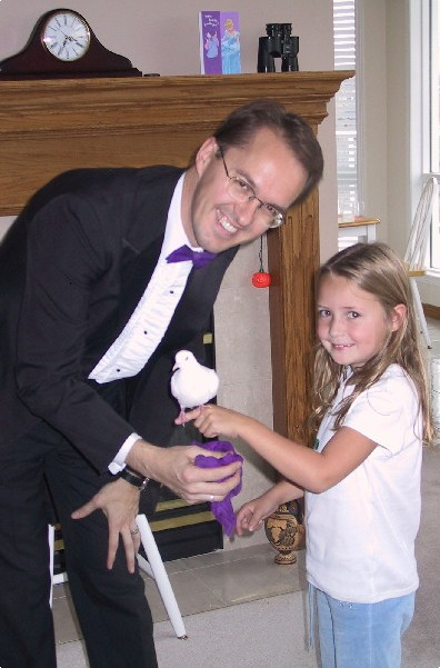 Richard Young the Magician and the birthday girl from Calgary, Alberta, Canada