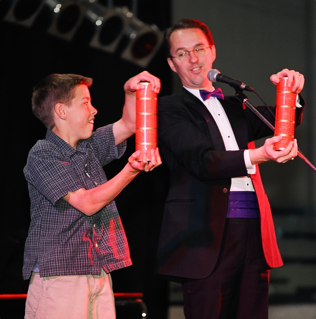 A student helping Richard Young the Magician in Fort Macleod, Alberta, Canada